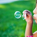 image of a young girl blowing bubbles
